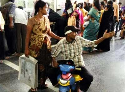 Unable to pay bribe for wheelchair, patient uses toy tricycle