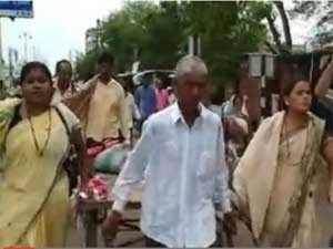 Family carries woman's body out of govt hospital on push-cart