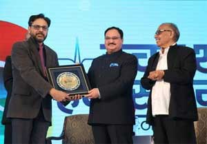 Health Minister Awards Dr Sumit Sinha for special contribution to medicine