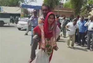 Mathura: Woman carries differently-abled husband on shoulders to obtain disability certificate